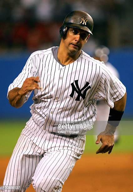 Jorge Posada of the New York Yankees runs between second and third base against the New York Mets at Yankee Stadium on July 2 2006 in New York