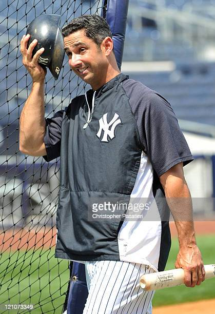 Jorge Posada of the New York Yankees steps out of the batting cage during practice prior to the game against the Tampa Bay Rays at Yankee Stadium on...