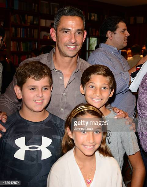 Jorge Posada pose for picture with fans during his wife Laura Posada book signing 'La dieta mental' at Books and BooksGables on June 4 2015 in Coral...