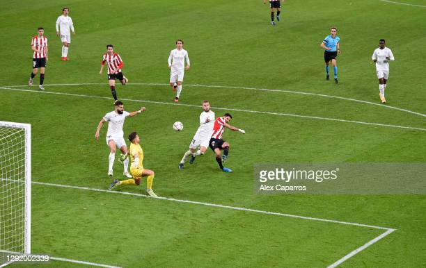 Jorge Pulido of Huesca fouls Kenan Kodro of Athletic Bilbao leading to a penalty during the La Liga Santander match between Athletic Club and SD...