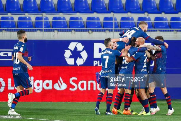 Jorge Pulido of SD Huesca celebrates scoring his side's 2nd goal with his team mates during the La Liga Santander match between SD Huesca and Granada...