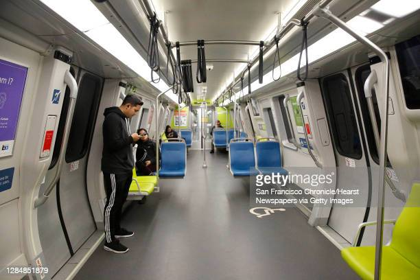 Jorge Quila of San Francisco is one of the few passengers riding on a BART train on Monday, March 16, 2020 in San Francisco, Calif. The Golden Gate...