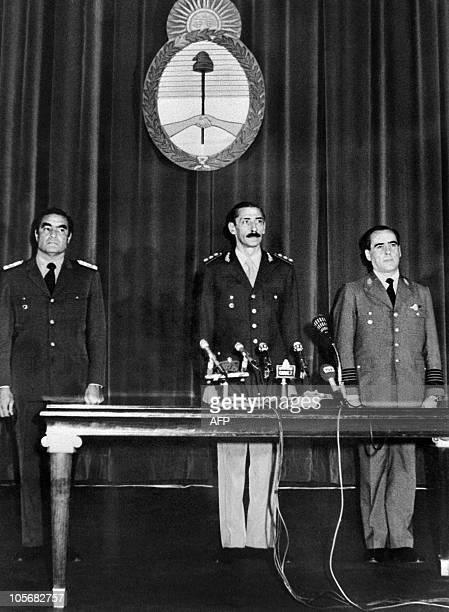 Jorge Rafael Videla President of Argentina is surrounded by Admiral Eduardo Emilio Massera and General Orlando Ramon Agosti 24 March 1976 in Buenos...