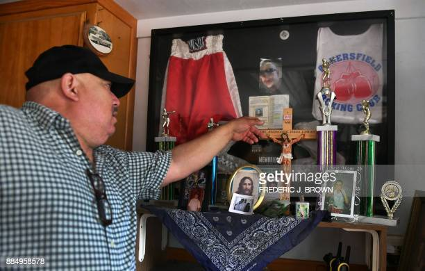 Jorge Ramirez points to a picture of his son Jorge Ramirez a former amatuer boxing champion on November 17 2017 at his home in Bakersfield Kern...