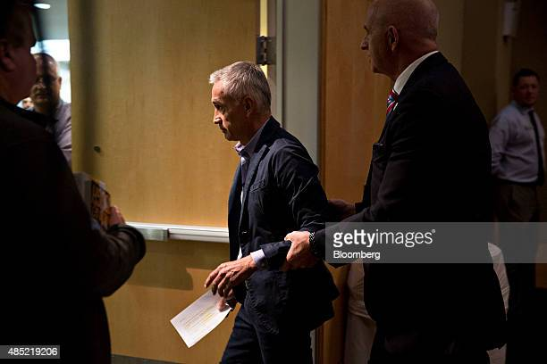 Jorge Ramos a news anchor at Univision is escorted out of a news conference with Donald Trump president and chief executive of Trump Organization Inc...