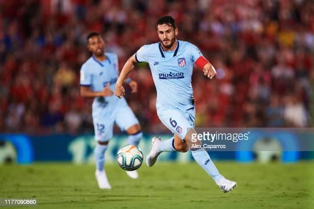 Jorge Resurreccion 'Koke' of Atletico de Madrid runs with the ball during the La Liga match between RCD Mallorca and Club Atletico de Madrid at...