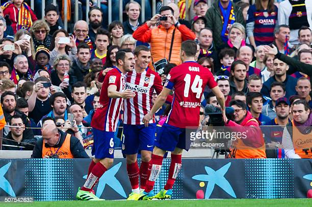 Jorge Resurreccion 'Koke' of Club Atletico de Madrid celebrates with his teammates Antoine Griezmann and Gabi Fernandez after scoring the opening...