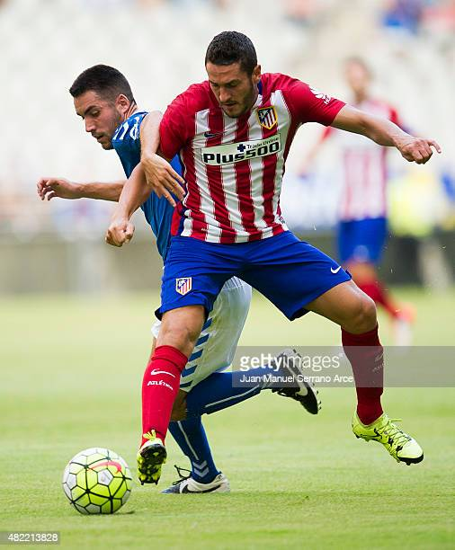Jorge Resurreccion 'Koke' of Club Atletico de Madrid duels for the ball with Miguel Linares of Real Oviedo during a pre season friendly match between...