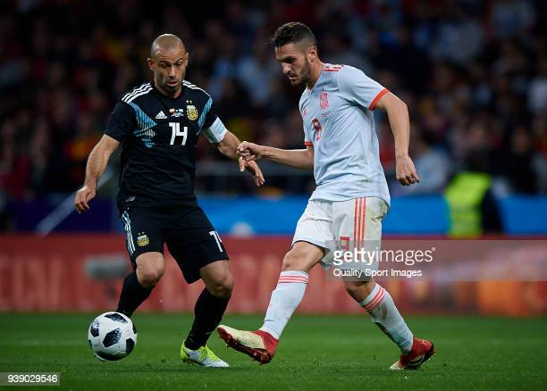 Jorge Resurreccion Koke of Spain competes for the ball with Javier Mascherano of Argentina during the International friendly match between Spain and...
