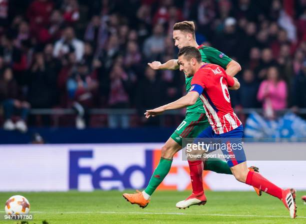 Jorge Resurreccion Merodio Koke of Atletico de Madrid fights for the ball with Anton Miranchuk of FC Lokomotiv Moscow during the UEFA Europa League...