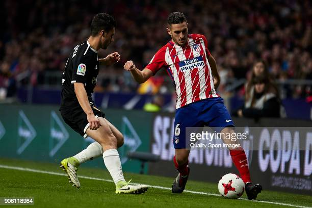 Jorge Resurrecion 'Koke' of Atletico de Madrid is challenged by Sebastien Corchia of Sevilla FC during the Copa del Rey Round of 8 first Leg match...