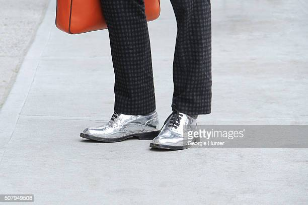 Jorge Rios is seen at Industria Superstudios wearing silver Good As Folk brogue shoes grey Gucci suit pants and orange leather Hackett London bag...