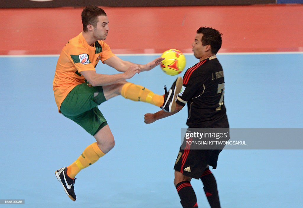 Jorge Rodriguez of Mexico (R) battles for the ball with Aaron Cimitile of Australia (L) during their first round football match of the FIFA Futsal World Cup 2012 in Bangkok on November 5, 2012.