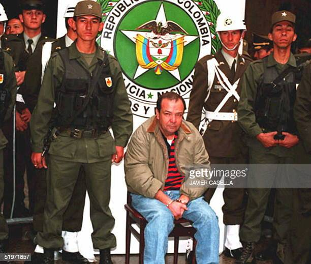 Jorge Rodriguez Orejuela suspected of being a major operative in the Cali Colombia drug cartel sits handcuffed before reporters at a press conference...