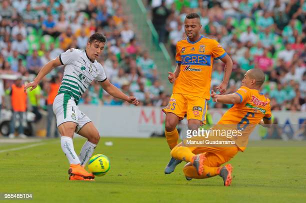 Jorge Sache of Santos and Jorge Torres of Tigres during the quarter finals second leg match between Santos Laguna and Tigres UANL as part of the...