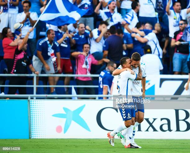 Jorge Saenz of CD Tenerife celebrates after scoring with his team mate Victor Jode Anino 'Vitolo' of CD Tenerife during La Liga 2 play off round...