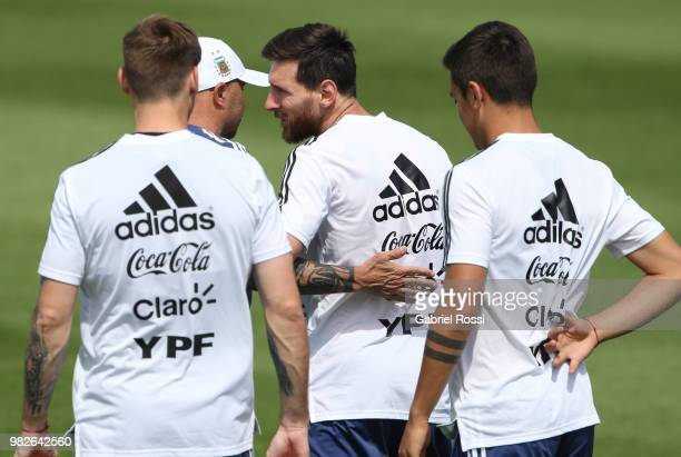 Jorge Sampaoli coach of Argentina acknowledges Lionel Messi of Argentina on his 31st birthday prior a training session at Stadium of Syroyezhkin...
