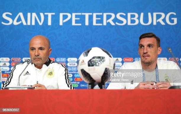 Jorge Sampaoli coach of Argentina and Franco Armani of Argentina look on prior the official press conference ahead of the match against Nigeria at...