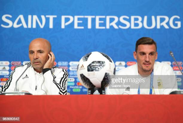 Jorge Sampaoli coach of Argentina and Franco Armani of Argentina looks on prior the official press conference ahead of the match against Nigeria at...