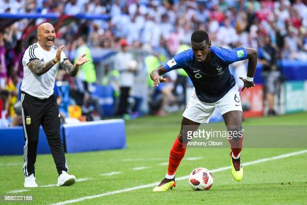 Jorge Sampaoli coach of Argentina and Paul Pogba of France during the FIFA World Cup Round of 16 match between France and Argentina at Kazan Arena on...