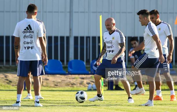 Jorge Sampaoli coach of Argentina and players of Argentina warm up during a training session at Stadium of Syroyezhkin sports school on June 27, 2018...