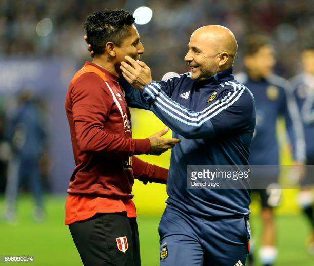 Jorge Sampaoli coach of Argentina greets Renato Tapia of Peru before a match between Argentina and Peru as part of FIFA 2018 World Cup Qualifiers at...