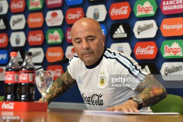 Jorge Sampaoli coach of Argentina looks at a folder during a press conference at 'Julio Humberto Grondona' training camp on March 01 2018 in Ezeiza...