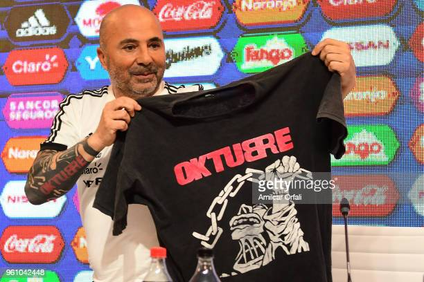 Jorge Sampaoli coach of Argentina shows a tshirt with the cover of the music album Oktubre of local rock band Patricio Rey y sus Redonditos de Ricota...