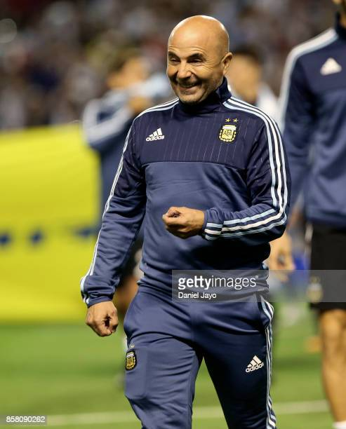 Jorge Sampaoli coach of Argentina smiles as he walks onto the field before a match between Argentina and Peru as part of FIFA 2018 World Cup...