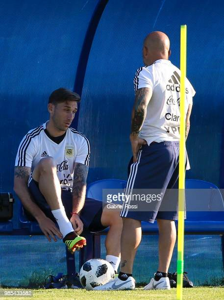 Jorge Sampaoli coach of Argentina talk with Lucas Biglia of Argentina prior a training session at Stadium of Syroyezhkin sports school on June 27...