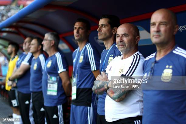 Jorge Sampaoli Head coach of of Argentina looks on with staff members during the 2018 FIFA World Cup Russia Round of 16 match between France and...