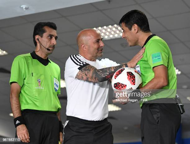 Jorge Sampaoli Head coach of of Argentina talks to Referee Alireza Faghani during the 2018 FIFA World Cup Russia Round of 16 match between France and...
