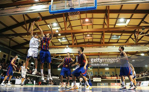 Jorge Sanchez #4 of Real Madrid competes with Aitor Gomez #15 of FC Barcelona during the Final of 2011 Junior Tournament Ciutat de L'Hospitalet...