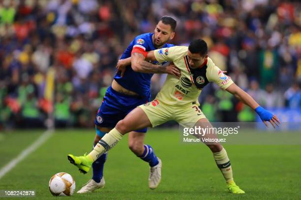 Jorge Sanchez of America struggles for the ball against Edgar Mendez of Cruz Azul during the final first leg match between America and Cruz Azul as...