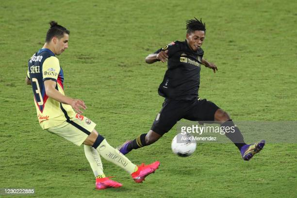 Jorge Sanchez of Club America kicks the ball past Latif Blessing of Los Angeles FC during the CONCACAF Champions League semifinal game at Exploria...