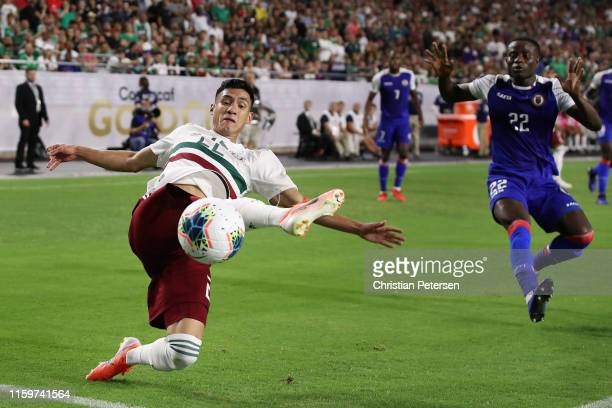 Jorge Sanchez of Mexico attempts a shot ahead of Alex Christian of Haiti during the second half of the CONCACAF Gold Cup semi-final match at State...