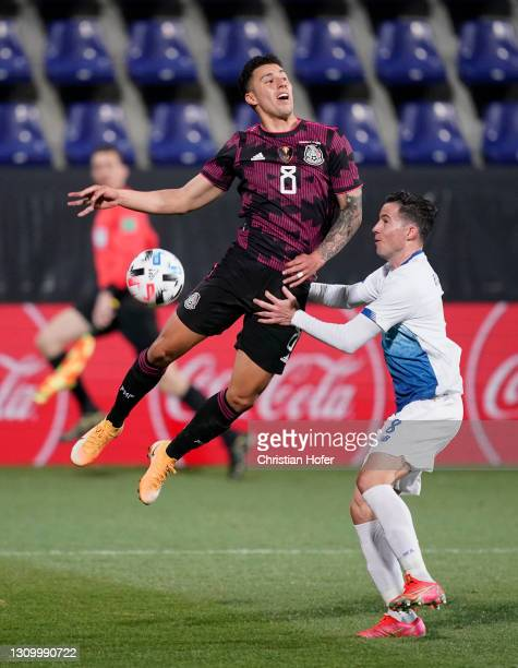 Jorge Sanchez of Mexico battles for a header with Bryan Oviedo of Costa Rica during the International Friendly match between Costa Rica and Mexico at...