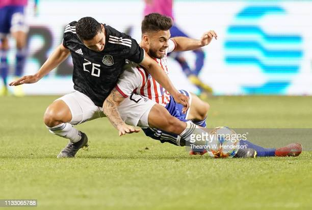 Jorge Sanchez of the Mexico National team battling for the ball collides with Hector Villalba of Paraguay during the second half of their soccer game...