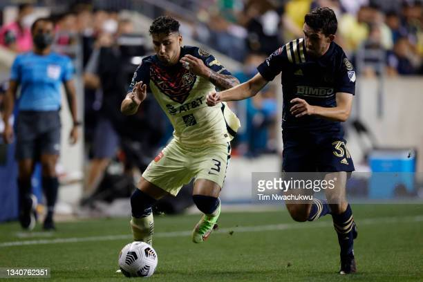 Jorge Sánchez of Club America and Leon Flach of Philadelphia Union battle for possession during the first half during the semifinal second leg match...