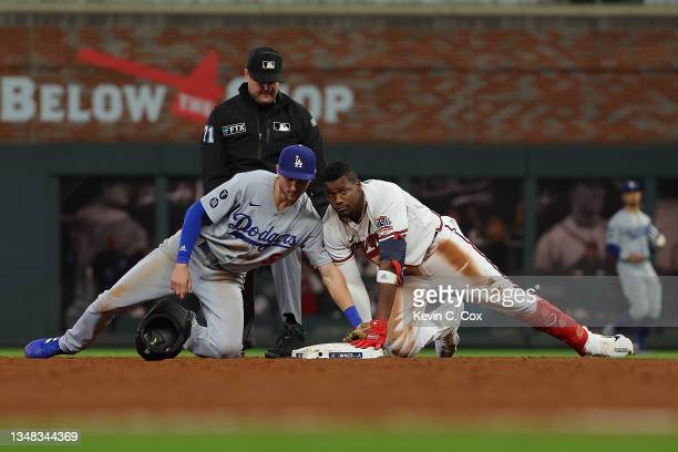 Jorge Soler of the Atlanta Braves beats a tag at second base by Trea Turner of the Los Angeles Dodgers during the eighth inning of Game Six of the...