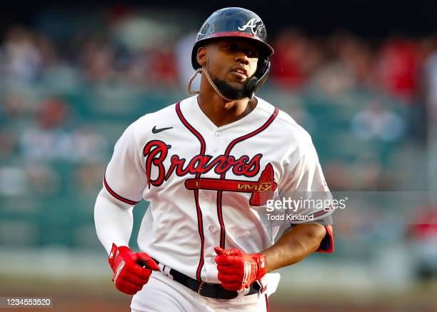 Jorge Soler of the Atlanta Braves rounds second after hitting a solo home run in the first inning of an MLB game against the Washington Nationals at...