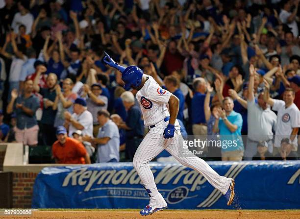 Jorge Soler of the Chicago Cubs celebrates after hitting a home run against the Pittsburgh Pirates during the ninth inning to tie the game at Wrigley...