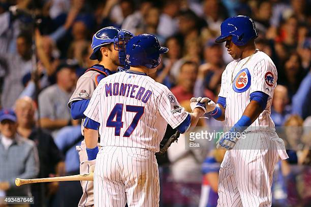Jorge Soler of the Chicago Cubs celebrates with Miguel Montero after hitting a solo home run in the fourth inning against Jacob deGrom of the New...