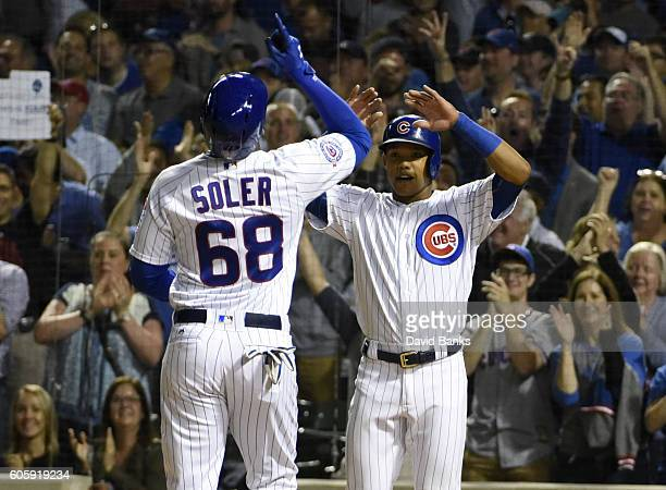 Jorge Soler of the Chicago Cubs is greeted by Addison Russell after hitting a tworun homer against the Milwaukee Brewers during the second inning on...