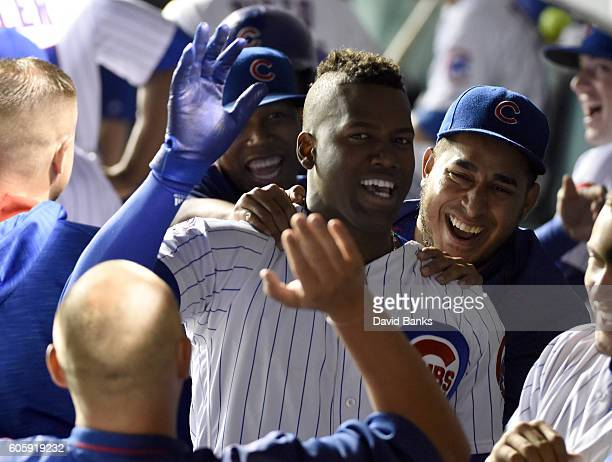 Jorge Soler of the Chicago Cubs is greeted by teammates after hitting a tworun homer against the Milwaukee Brewers during the second inning on...