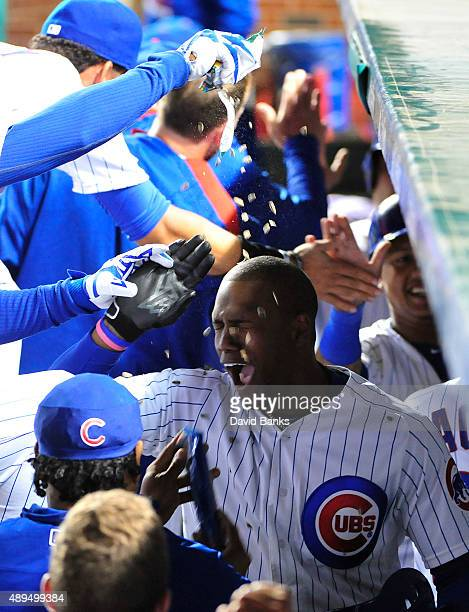 Jorge Soler of the Chicago Cubs is showered with sunflower seeds by his teammates after hitting a threerun home run against the Milwaukee Brewers...