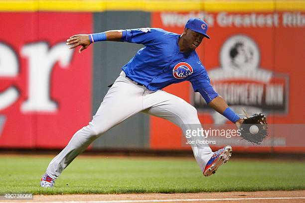 Jorge Soler of the Chicago Cubs is unable to catch a ball hit near the right field line by Brandon Phillips of the Cincinnati Reds in the first...