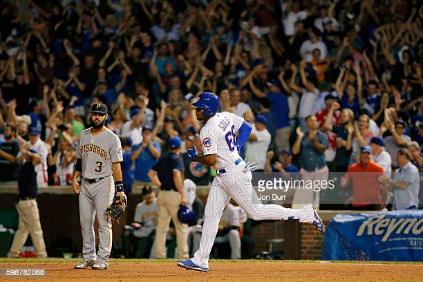 Jorge Soler of the Chicago Cubs rounds the bases after hitting a home run as Sean Rodriguez of the Pittsburgh Pirates looks on during the ninth...