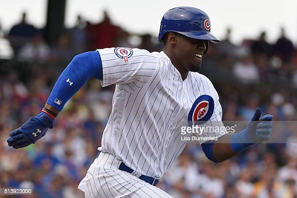 Jorge Soler of the Chicago Cubs runs to first base against the Cincinnati Reds on March 5 2016 in Mesa Arizona