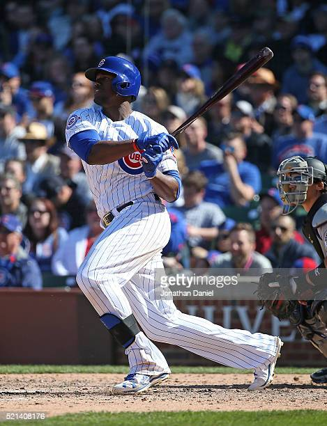 Jorge Soler of the Chicago Cubs singles in the 7th inning against the Colorado Rockies at Wrigley Field on April 15 2016 in Chicago Illinois All...